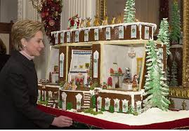 here u s first lady hillary clinton admires the gingerbread