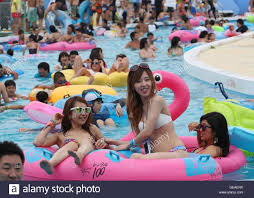 tokyo japan 24th july 2016 people try to cool off in a crowded