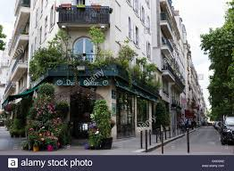 shop apartments paris city block with florist shop and apartments stock photo
