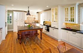 triangle shaped kitchen island l shaped kitchen layout with an arched overhang on the island