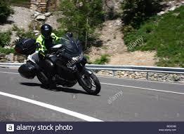 honda varadero motorcyclist cornering his honda varadero at speed on the c 28