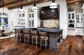 brown wooden bar stools and grey wooden kitchen island having