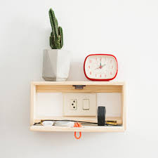 charging shelf station floating shelf that s also a charging station design milk
