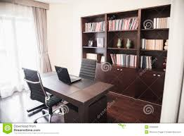 modern home office with bookshelves royalty free stock images