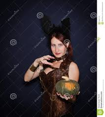 halloween long background pretty young witch with a pumpkin halloween stock photo image