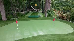 the benefits of a backyard putting green greenland turf