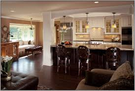 open concept living room integreted with bar kitchen and dining