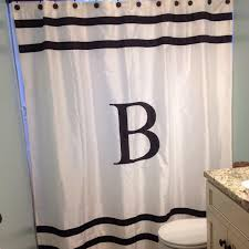 monogram shower curtain for a simple and beautiful look