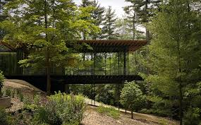 cantilevered deck dark walnut floors exterior modern with cable railing cantilevered