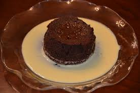 playing with flour chocolate soufflé with orange crème anglaise