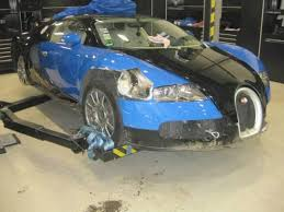 wrecked jeep cherokee wrecked bugatti veyron sells at auction for 277k