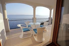 three bedroom apartment with a panoramic sea view and shared pool