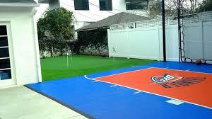 backyard basketball court flooring snapsports backyard home basketball court w custom okc theme