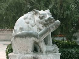 guard dog statue this is a statue of a lucky flea bitting guard dog outside the