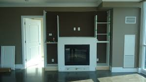white concrete frame fireplace combined with glaze wooden tall