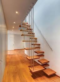 unique staircase railing interior design with wooden steps ideas