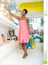 Home Interiors Store Woman Reaches For Product In Home Interiors Store Royalty Free