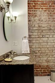 love how much an interior brick wall adds to the bathroom get the