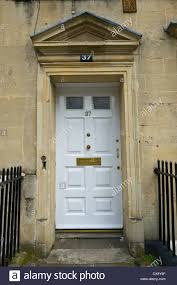 number 37 white wooden front door with triangular pediment of