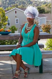 lola white hat and green dress stock photo image 44897722