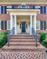 wrought iron railings exterior traditional with arches balcony