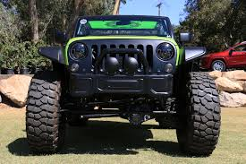 jeep concept truck behind the wheel of the 707 hp jeep trailcat concept