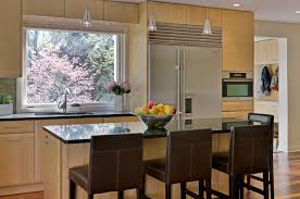 pinneo construction hunt drive princeton nj a new kitchen and an expanded dining room large expanses of glass fill the space with natural light neff cabinets and glass tile add to the clean