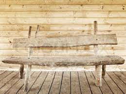 old wooden bench against wooden wall stock photo colourbox