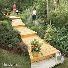 How To Landscape A Sloped Backyard - how to build a wooden boardwalk family handyman