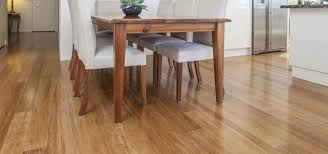 dining room with wooden table and bamboo flooring ways to repair