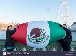 london uk 20 january 2017 activists wave a mexican flag on