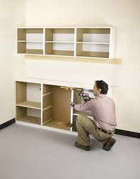 how to hang a cabinet to the wall installing garage cabinets