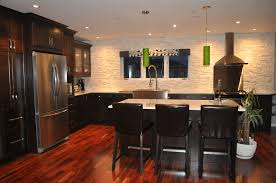 dark kitchen cabinets white granite with tigerwood flooring