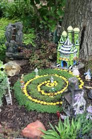 wizard of oz fairy garden dorothy toto lion scarecrow glinda
