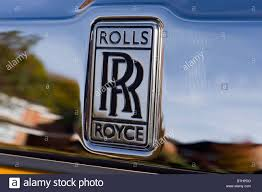 rolls royce badge rolls royce badge and insignia on the front end of a rolls royce