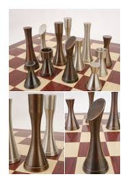 a contemporary heavy metal pewter and copper finished chess set