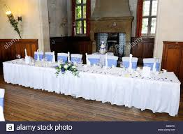 head table at wedding reception with blue and white decoration