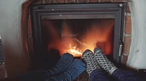 couple feet in woollen socks by the cozy fireplace 4k man and