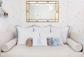 nursery with light gray daybed with gold bamboo mirror