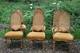 restful cane back dining chairs providing a thrilling dining traditional cane back dining chair with arm and armless design together with light brown upholstery for