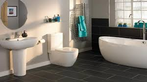 bathroom modern toilet on dark bathroom floor tile ideas with
