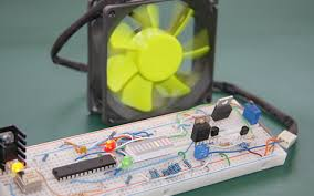 temperature activated light switch temperature controlled fan using 8051 microcontroller