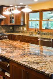 what color cabinets go with venetian gold granite gold color granite countertops kitchen ideas gold trend