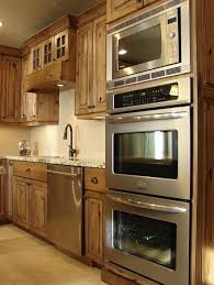 ceramic tile countertops rustic alder kitchen cabinets lighting