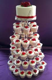 wedding cake and cupcakes roses wedding cake and cupcakes