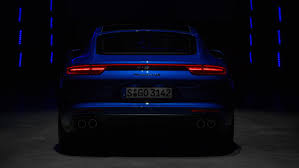 porsche headlights at night panamera the sports car among luxury saloons