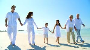 three generations of a loving family happily walking together on