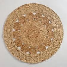 round jute rugs have a ton of tactile appeal for adding a layer of