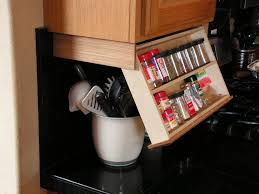 traditional kitchen space saving under cabinet spice rack