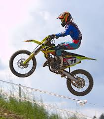 download freestyle motocross person doing stunt in motocross dirt bike free stock photo